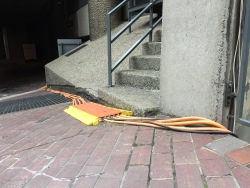 Orange Cables disappear down into Cromwell Basement